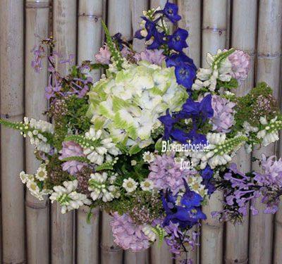 wit paars boeket laten bezorgen in Overveen