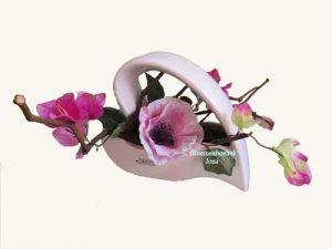 Zeide-bloemen opgemaakt in hart/bloemenboetiek Iona
