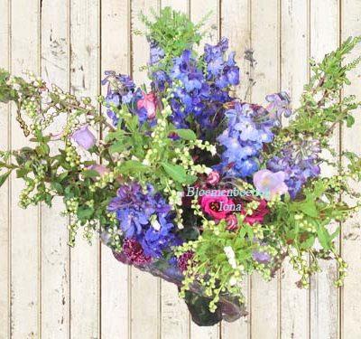 kleurrijk paas boeket maakt bloemenboetiek Iona